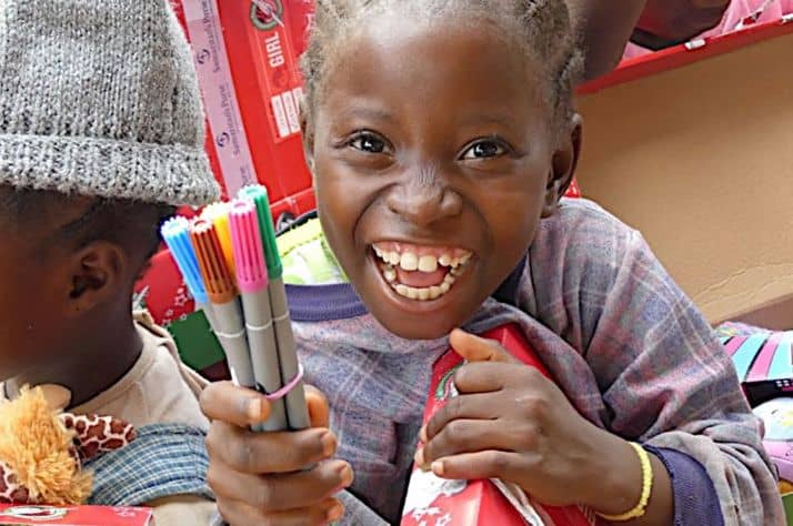 A girl from the isolated village of Vanyanpa, Liberia, rejoiced to receive markers in her Operation Christmas Child shoebox gift.