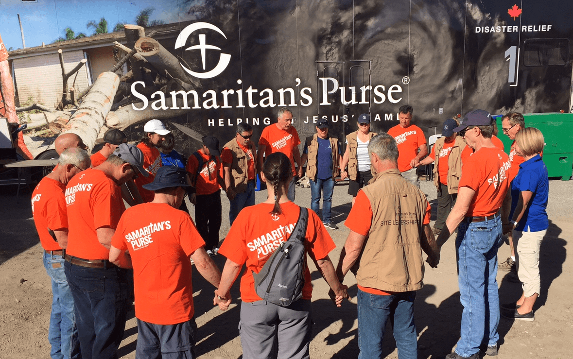 Samaritan's Purse site leadership team and volunteers, along with chaplains from the Billy Graham Evangelistic Association, come together to pray to start the day in Grand Forks, B.C..