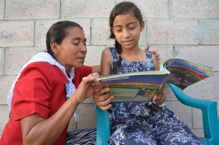 Maria DeCampos, who teaches The Greatest Journey at a church in El Salvador, reviews one of the 12 lessons Nataly, one of her students.