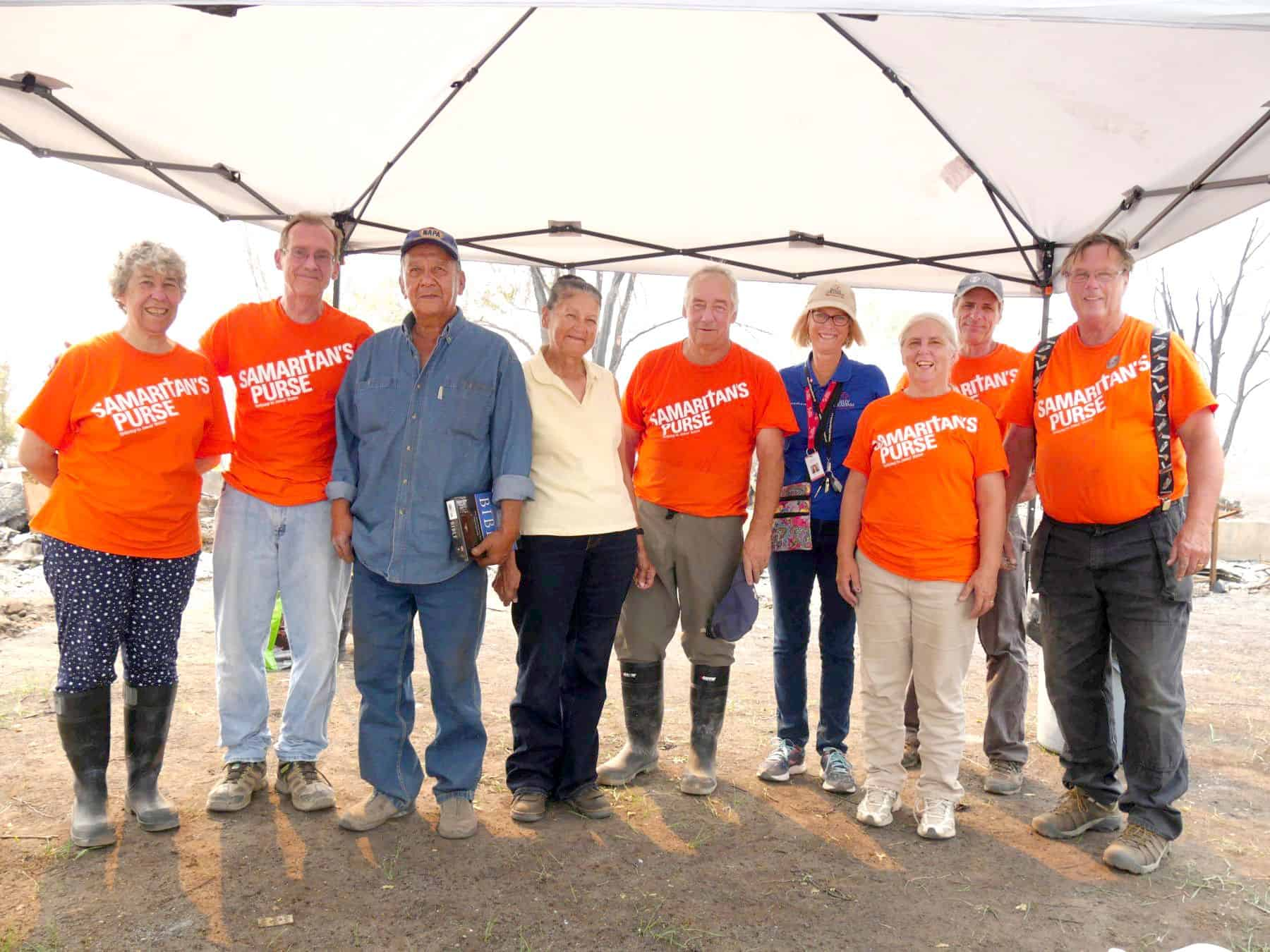 Ruth and her husband Les, pictured here with Samaritan's Purse volunteers and Billy Graham Rapid Response Team chaplains (pictured in blue), lost virtually everything they owned in the wildfire surrounding Ashcroft, BC.