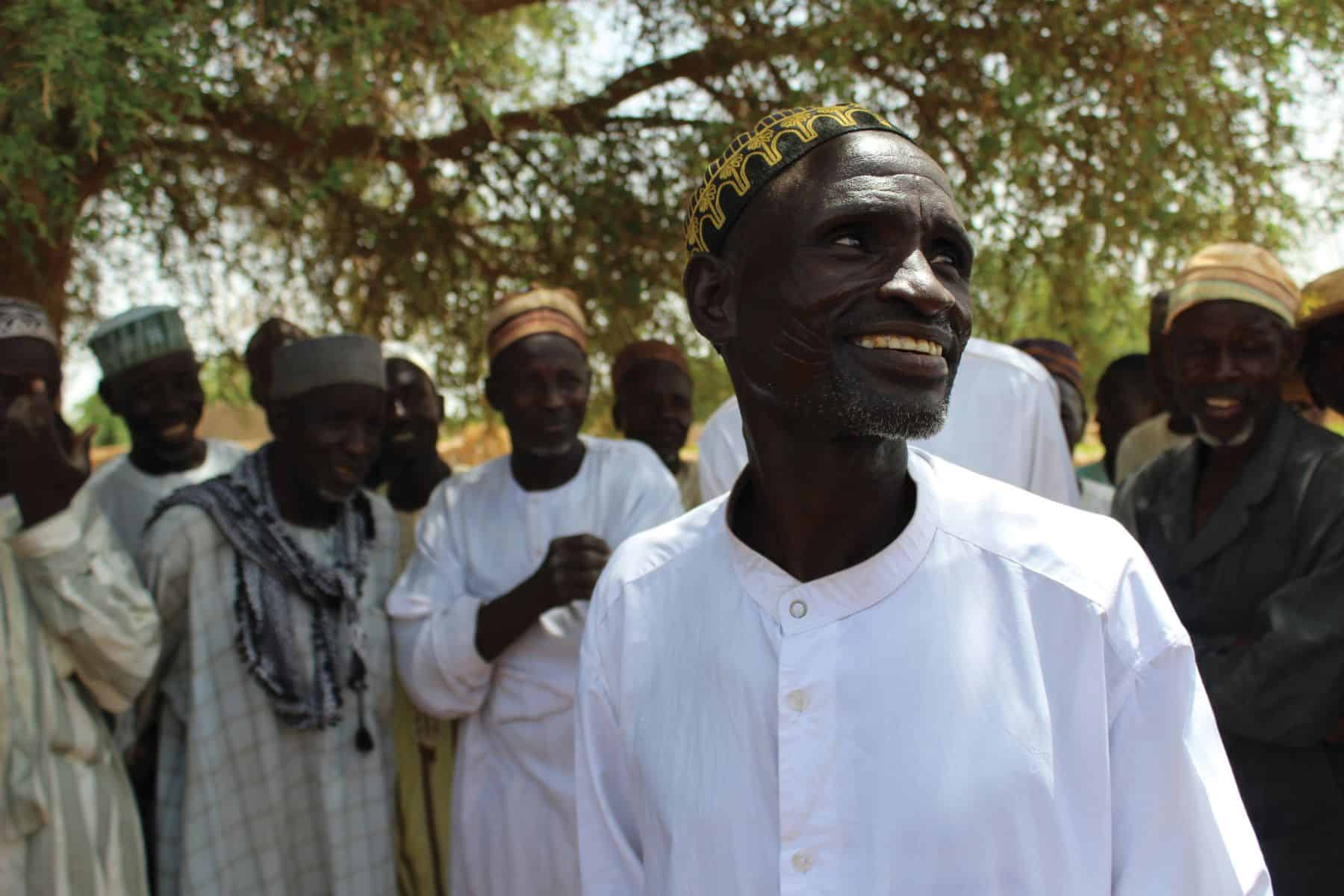 Zakari Yao is filled with joy over the transformed crops in his community.