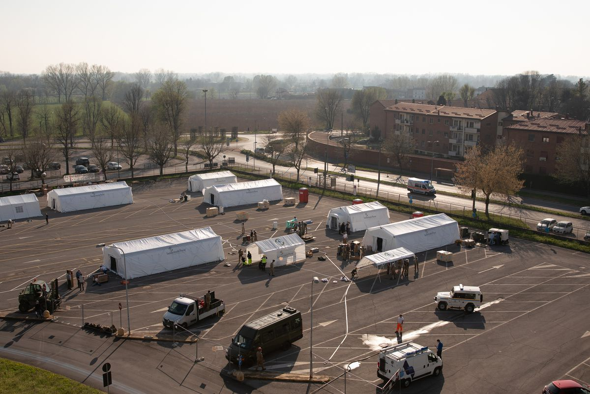 The Cremona emergency unit, erected in the parking lot next to the city's main hospital, is at full capacity, housing about 50 patients.