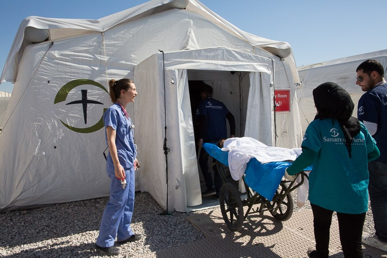 A patient is taken to the emergency room at the field hospital near Mosul.