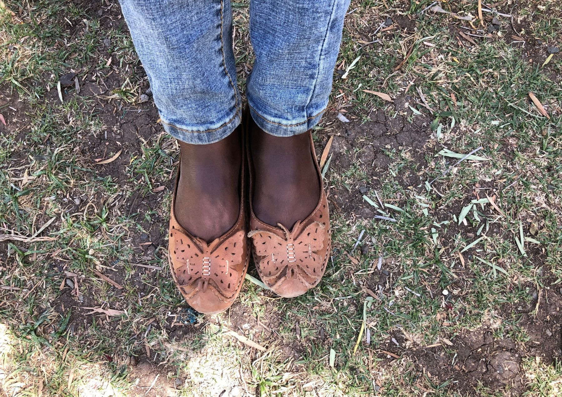To protect Senait's privacy we aren't showing her face. Her feet and shoes symbolize her new journey in Christ.