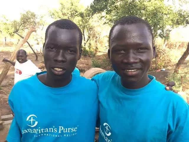 """Water is everything because it serves us to drink, to cook, to bathe and to lay bricks,"" said 16 year old Robert Djara John (right), who aspires to become a doctor. John helps to oversee one of Calgary-based Samaritan's Purse's wells that provide water to some of the one million South Sudanese refugees in Canada. Traveling alone, John zigzagged by foot for two weeks across South Sudan before finding sanctuary in South Sudan. As for his family: ""Honestly, I don't think that I will ever see them again."" Matthew Fisher / Postmedia News"
