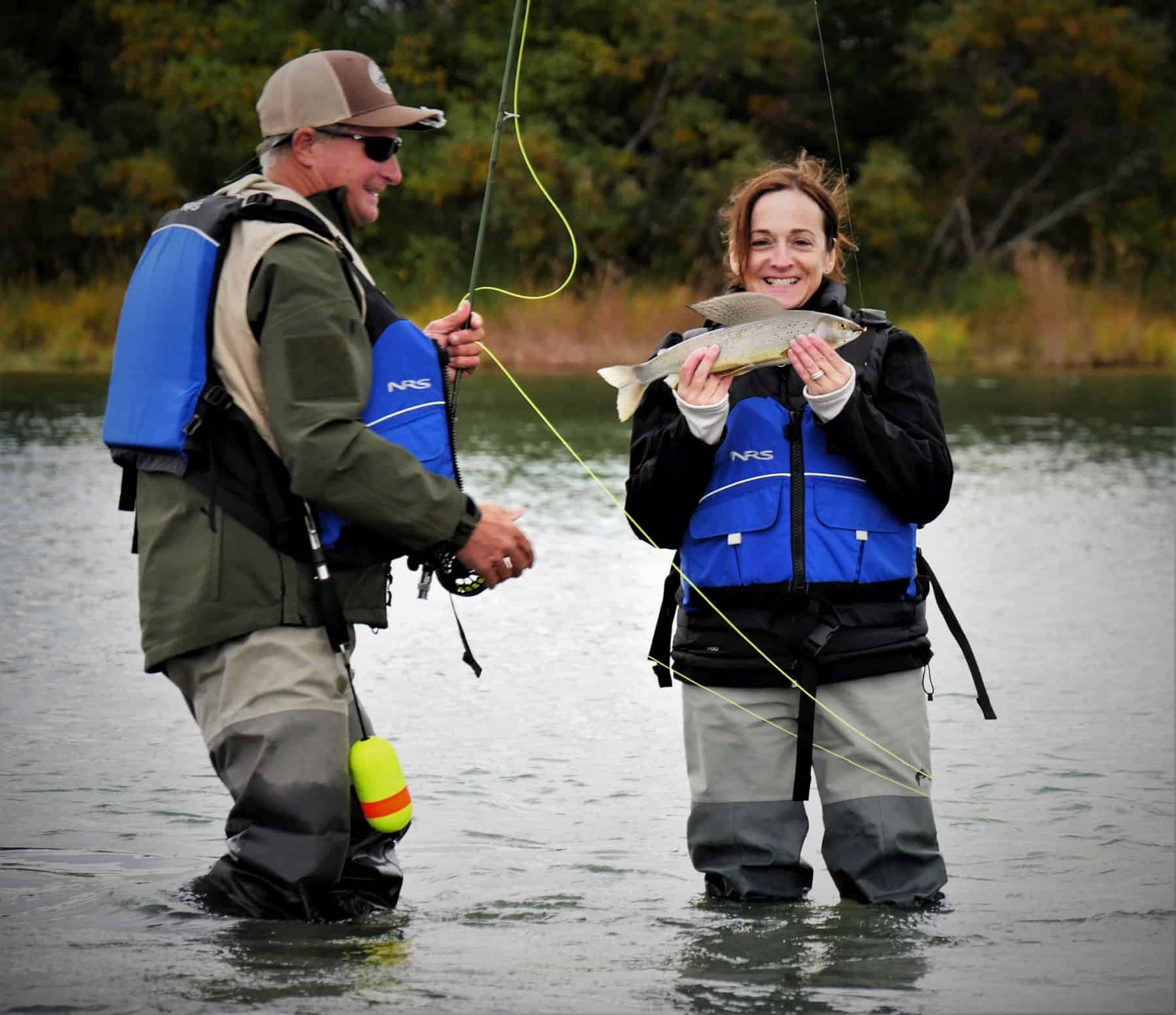 Carole was excited to catch one of her many fish including for Fly girl fishing charters