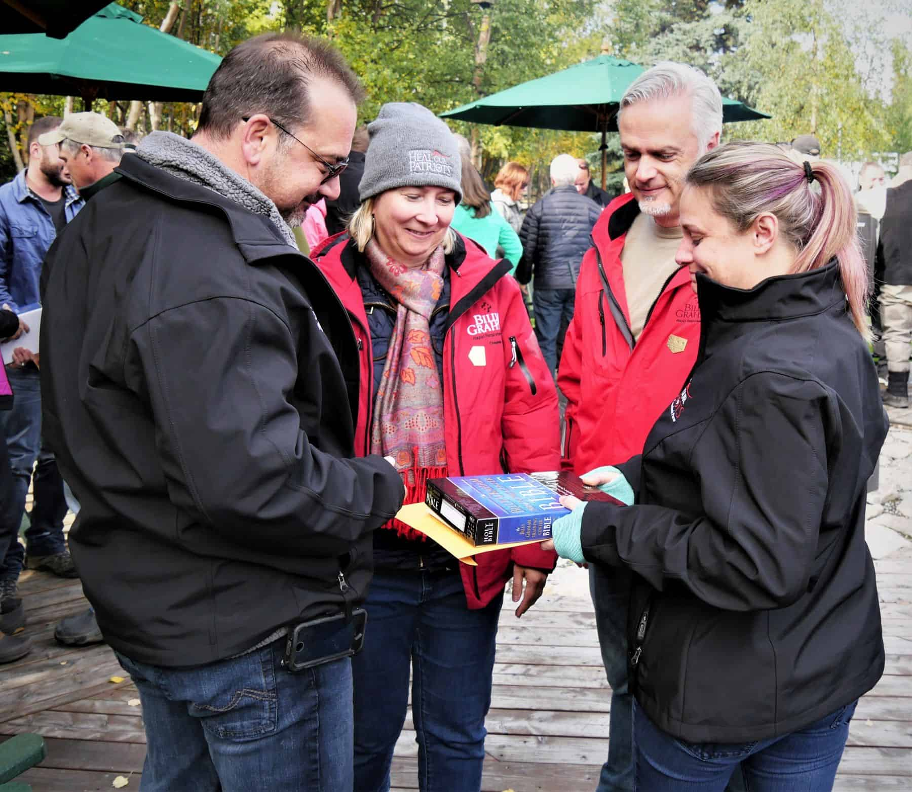 Canadian chaplains Irene and Laurent Trabadello presented Bibles signed by Franklin Graham and Operation Heal Our Patriots staff to couples at the end of the week in Port Alsworth, Alaska.