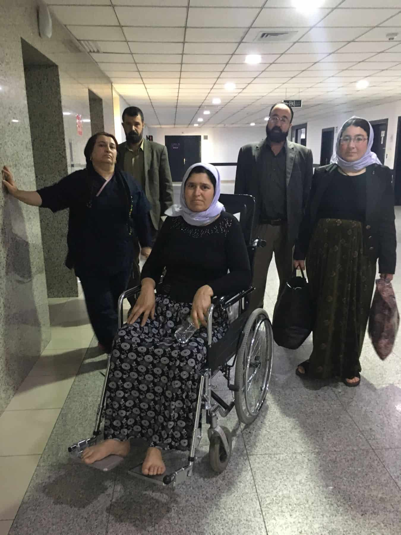 Halo leaving the hospital in Erbil, with family members, after surgery to repair her back.