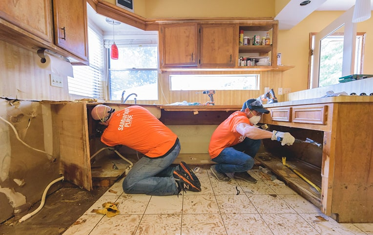 Volunteer teams are busy clearing homes of debris, damaged belongings, and mold-prone wall sections.