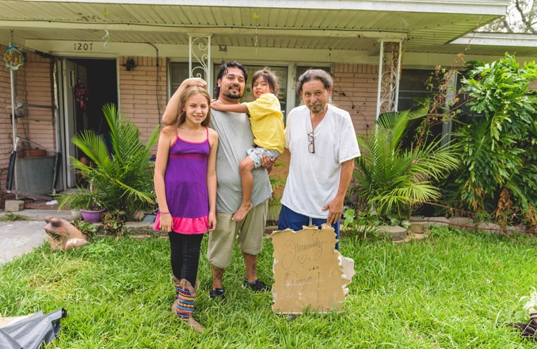 "Ian Hernandez (right) and his family hid in a room in the middle of their house during Hurricane Harvey. The children were so scared that they cried all night. Ian, who has been disabled for 27 years, had no idea how he would clean up after the storm. ""I promise you that I've never had help like this before. [Samaritan's Purse volunteers] were there when I needed them."""