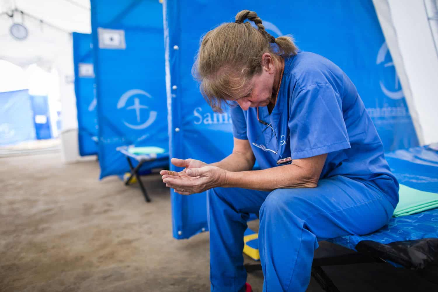 Nurse Regina Randolph spends time praying for the patients who will come to our treatment center.
