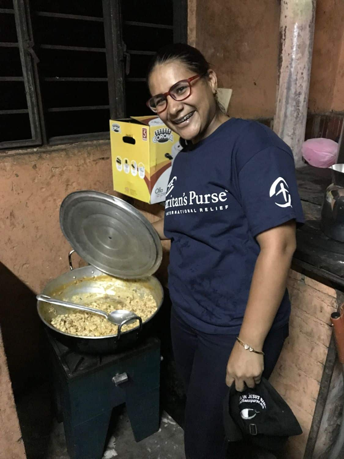 "One of our employees, preparing a hot meal for Venezuelan migrants at our roadside facility called the ""Shelter of Hope""."