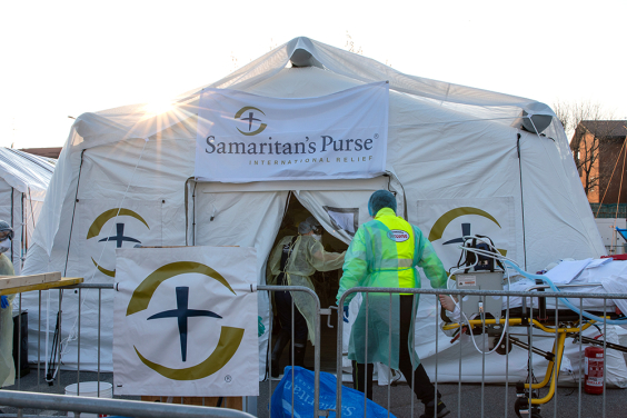 A patient is wheeled into the Samaritan's Purse field hospital.