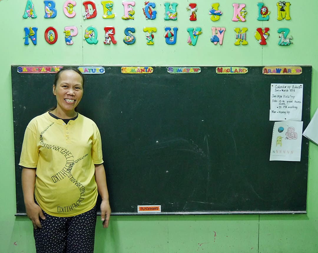 """Serving God and helping children is my joy."" Olive teaches at a slum in Manila, Philippines."